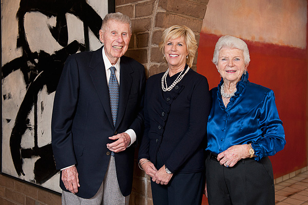 Harry W. Anderson, left, Mary Patricia Anderson Pence and Mary Margaret Anderson stand between two paintings, a Franz Kline and a Mark Rothko, which are part of the gift to Stanford.